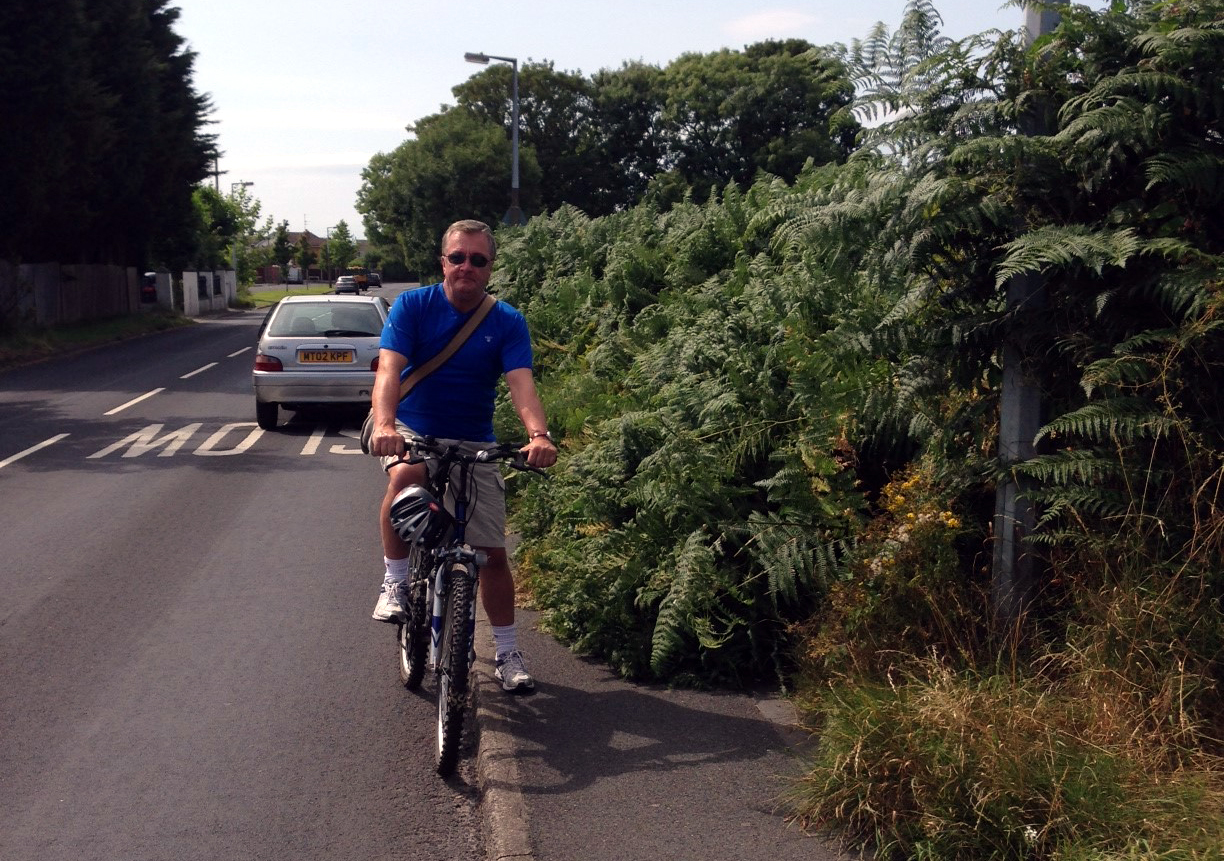 Maghull Labour councillor Patrick McKinley has asked for the overgrown bushes on Park Lane to be cut back as pedestrians are being forced into the road.