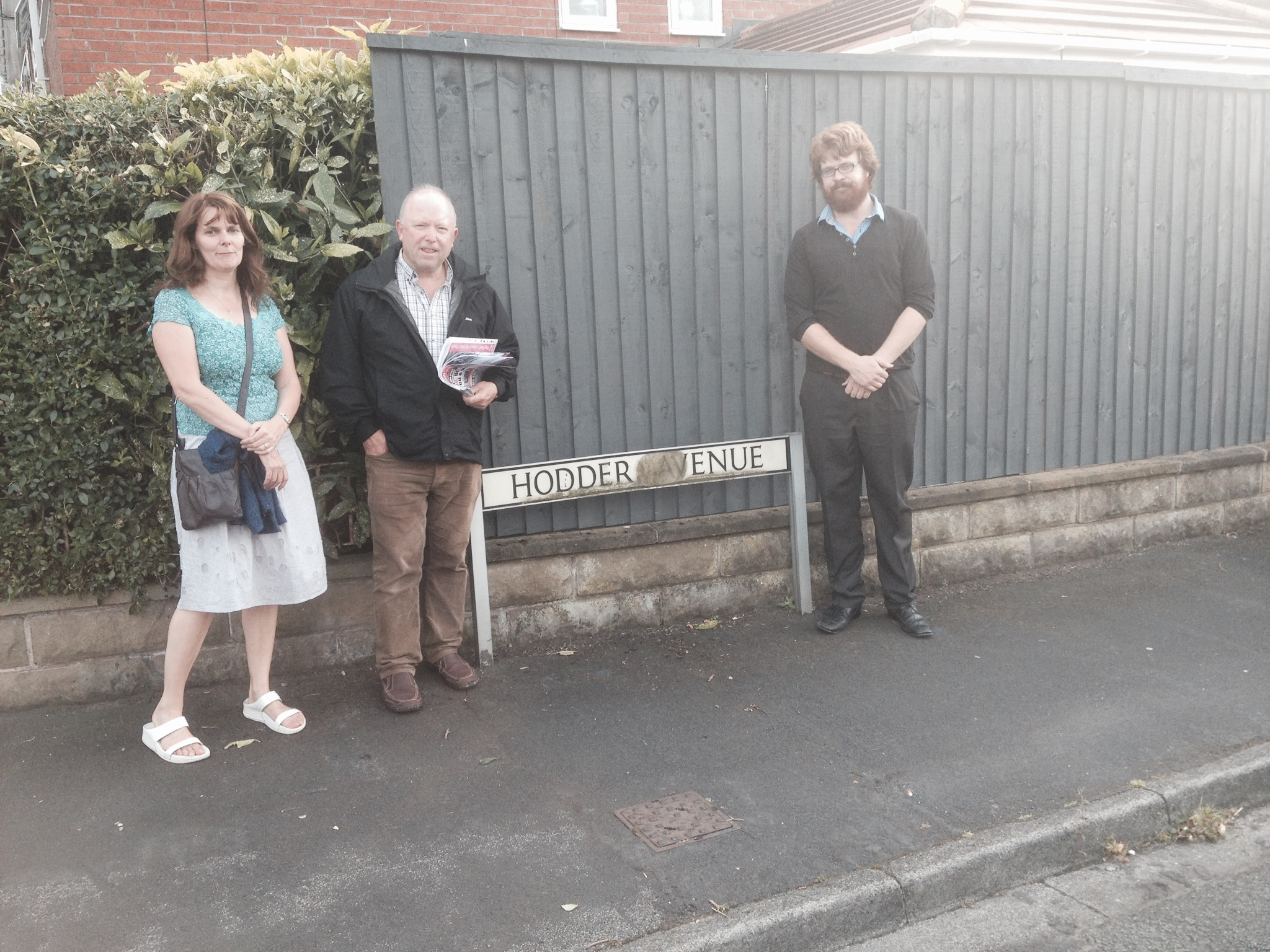 Maghull Labour Action Team's Clle Lynn Gatherer, John Sayers and Cllr Rob Owens are calling for Hodder Avenue signs to be replaced.