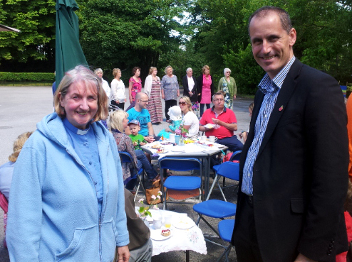 Sefton Central MP Bill Esterson at the St James' garden party in Green Lane, Maghull, with Rev Sue Jones with Singing Our Socks Off performing conducted by Steph Rooney.