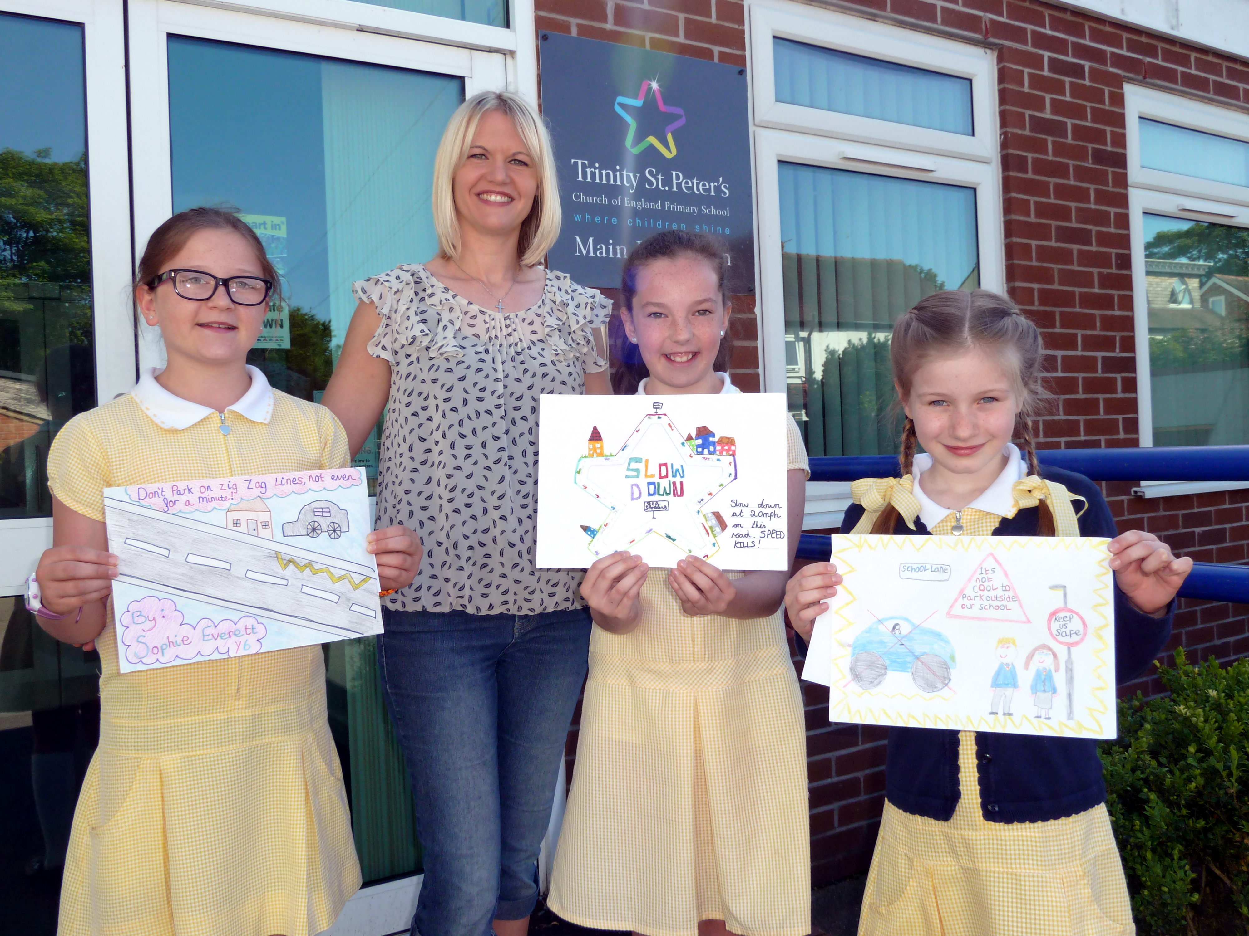 Formby Labour councillor Nina Killen with the winning Trinity St Peter's poster designers, Sophie Everett, Katie Burnett and Maisie Campbell-Myatt.