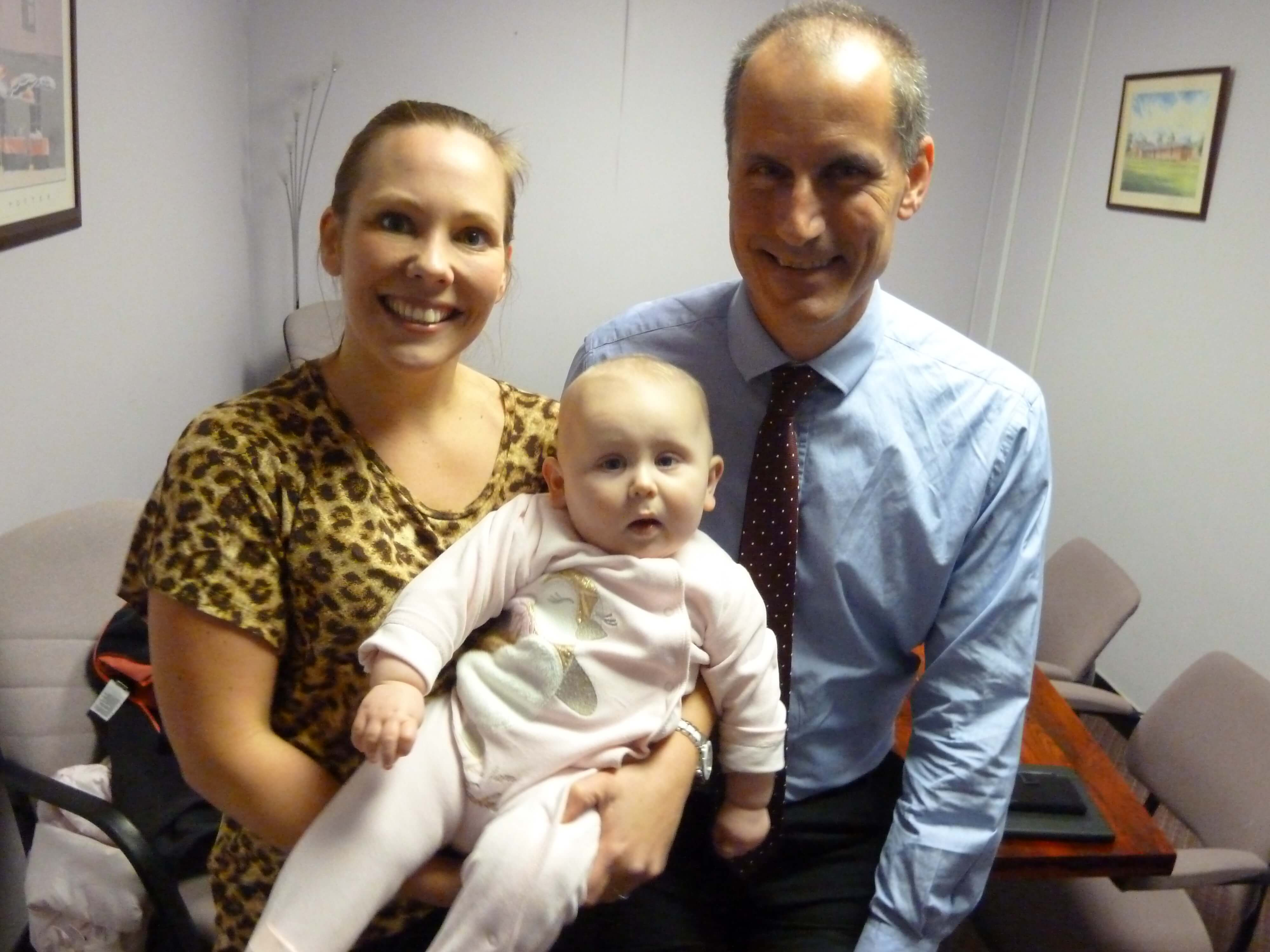 Labour MP Bill Esterson with eight-month-old Summer and mother Jasmine Jimbris.