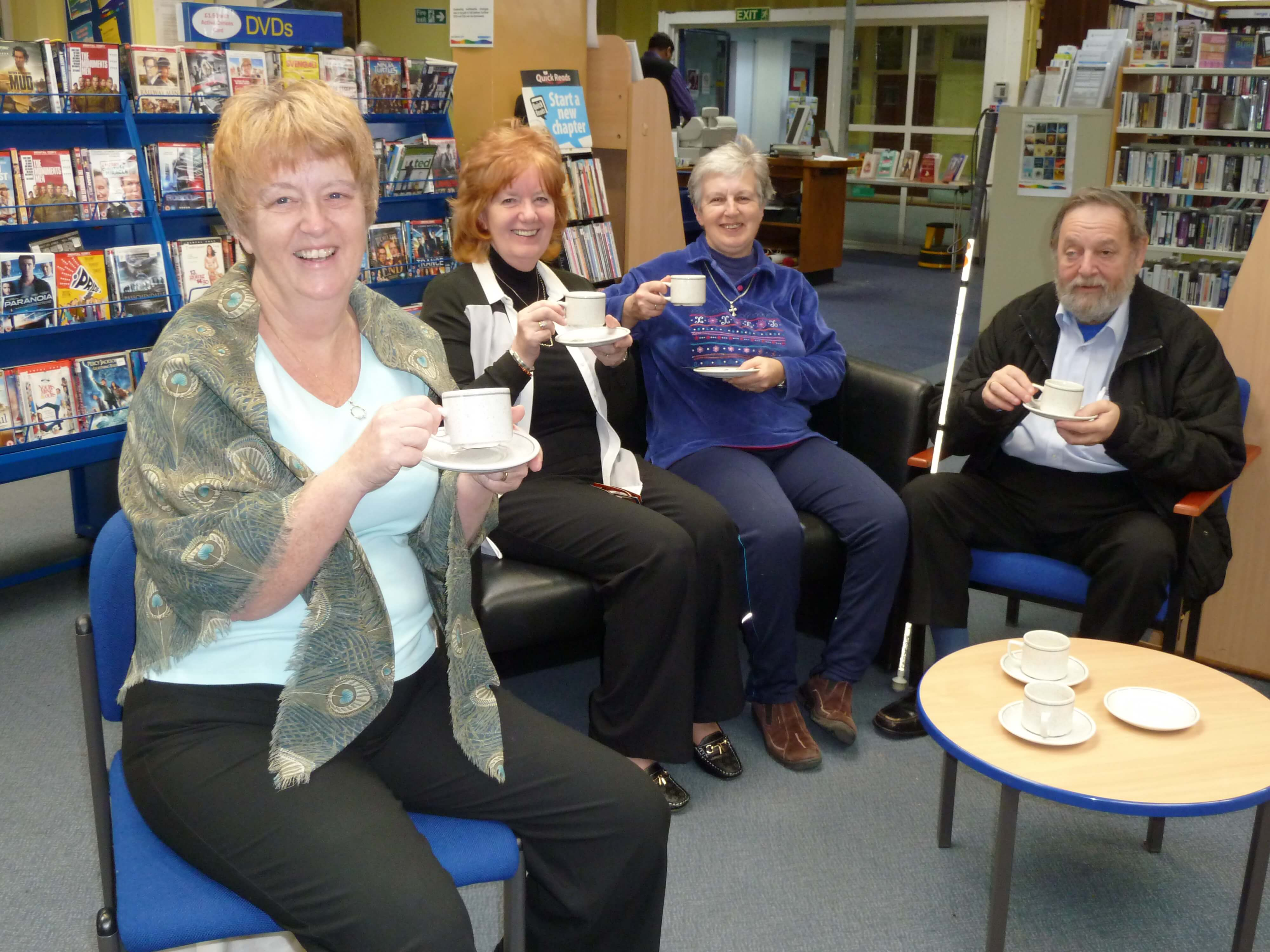 Ravenmeols Ward Labour councillor Catie Page and fellow Formby Hub co-ordinators Heather Davies and Jan Sterling with Derek enjoying a coffee and some cake.