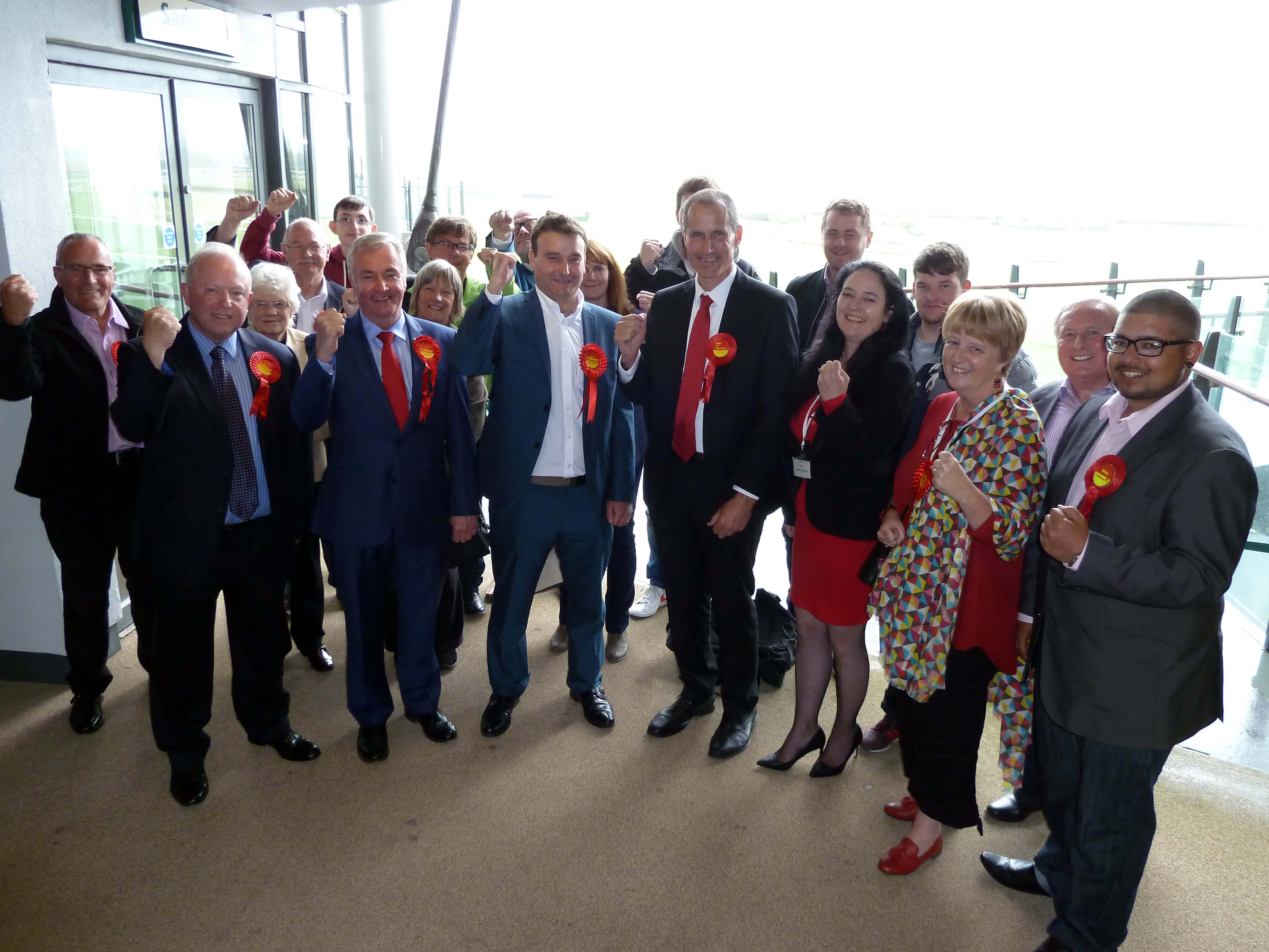 Sefton Central Labour MP Bill Esterson and supporters celebrate being first past the post in the General Election in Sefton Central following the count at Aintree Racecourse.