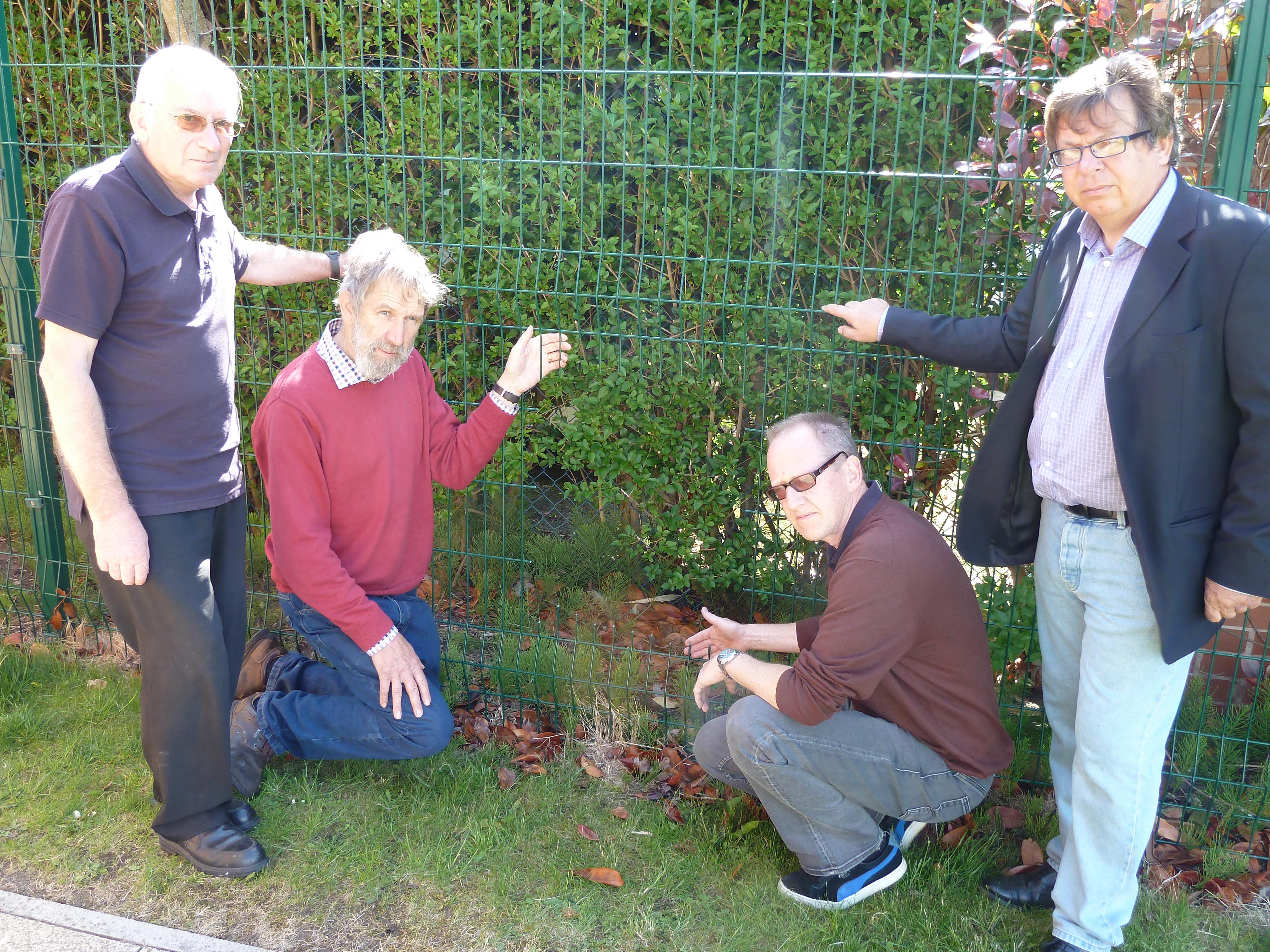 Lydiate Parish Council chairman Cllr John Bailey and vice chairman Cllr Andy Wilson with Lydiate Community Centre caretakers Keith Hawkins and Craig Bramwell with the recently damaged fencing.
