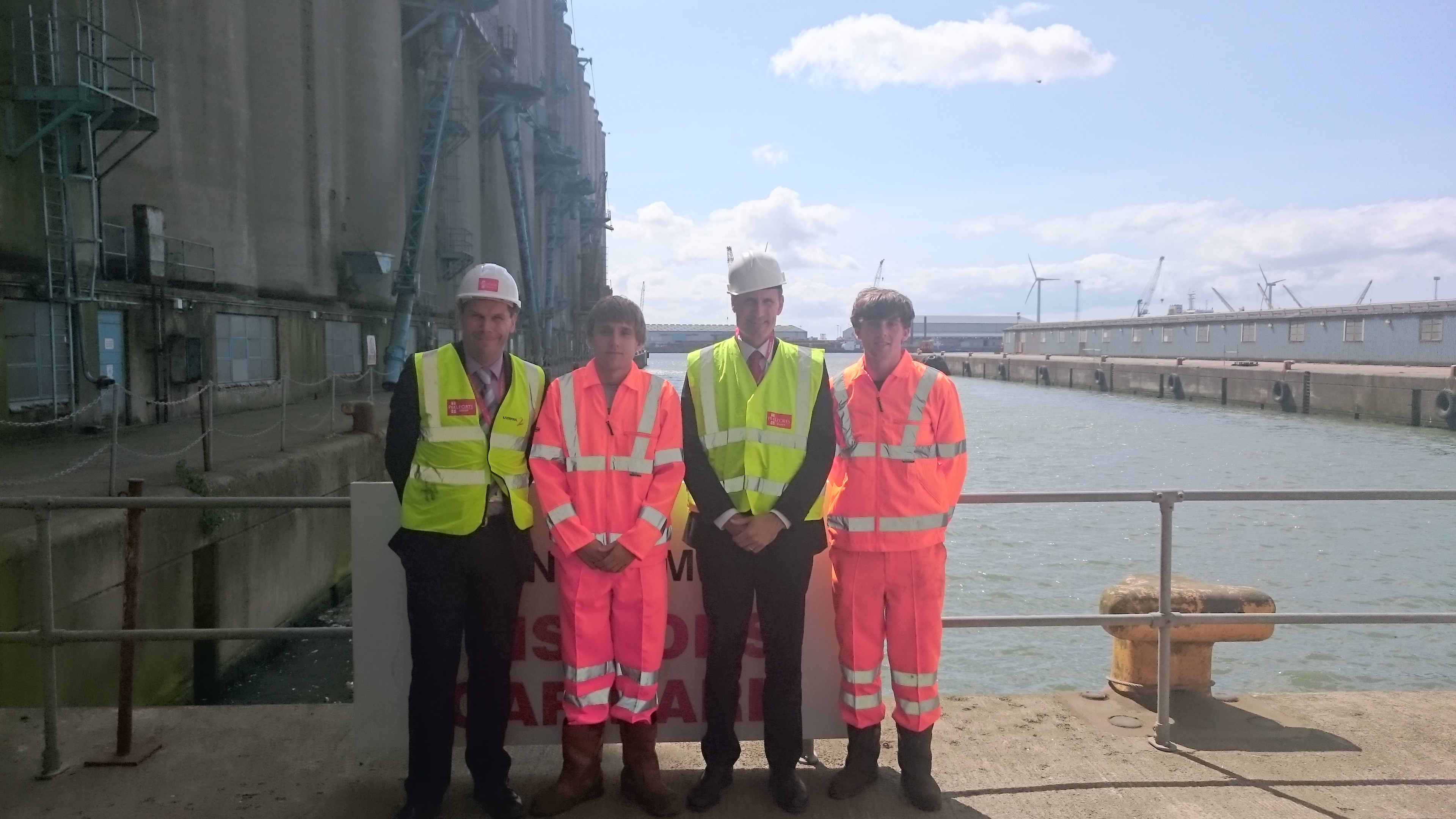 Sefton Central Labour MP Bill Esterson with Peel Ports' terminal manager Richard Watson and apprentices Karl Jones and Jon King.