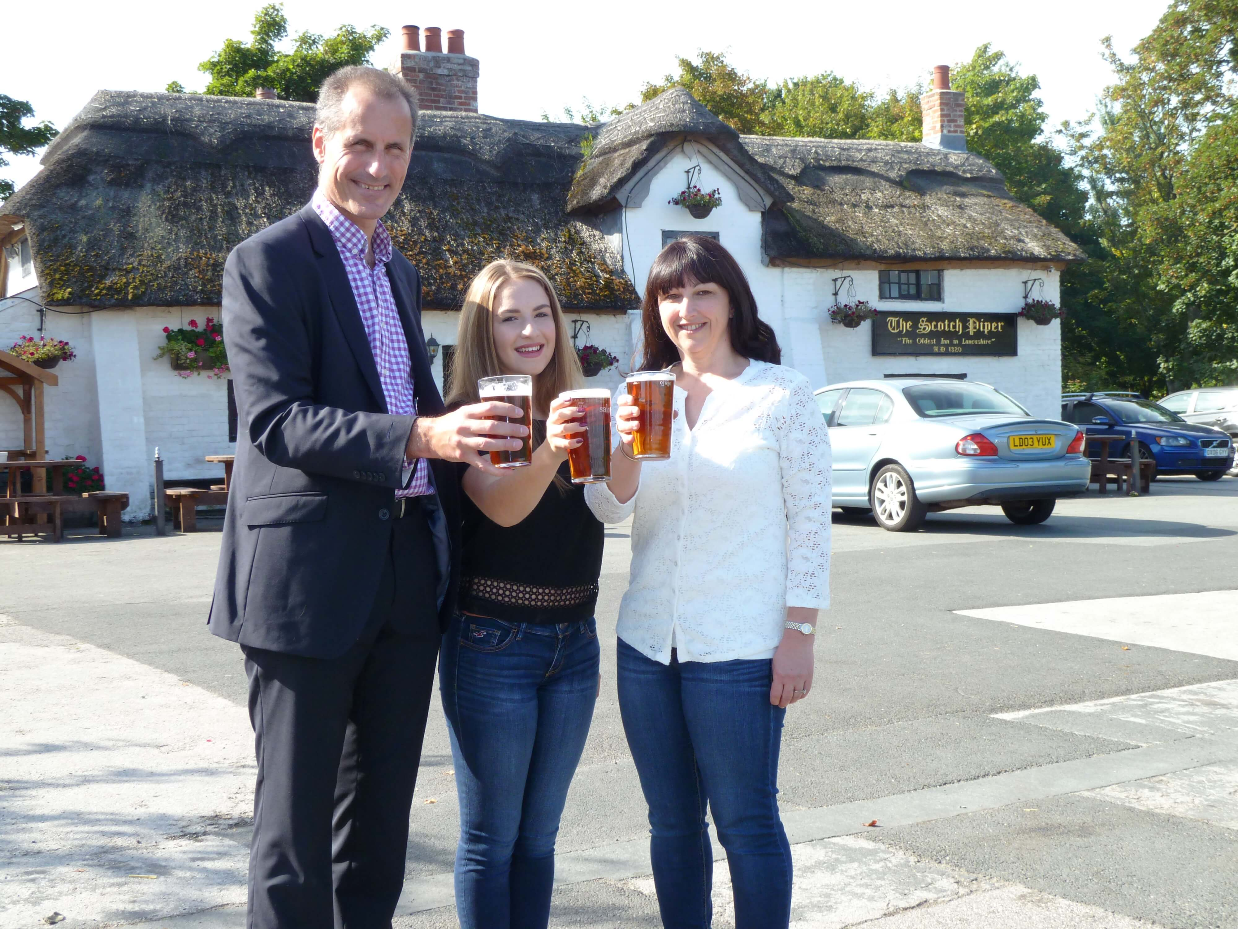 Sefton Central Labour MP Bill Esterson raises a glass with Scotch Piper Inn director Julie Pringle and her daughter Emma.