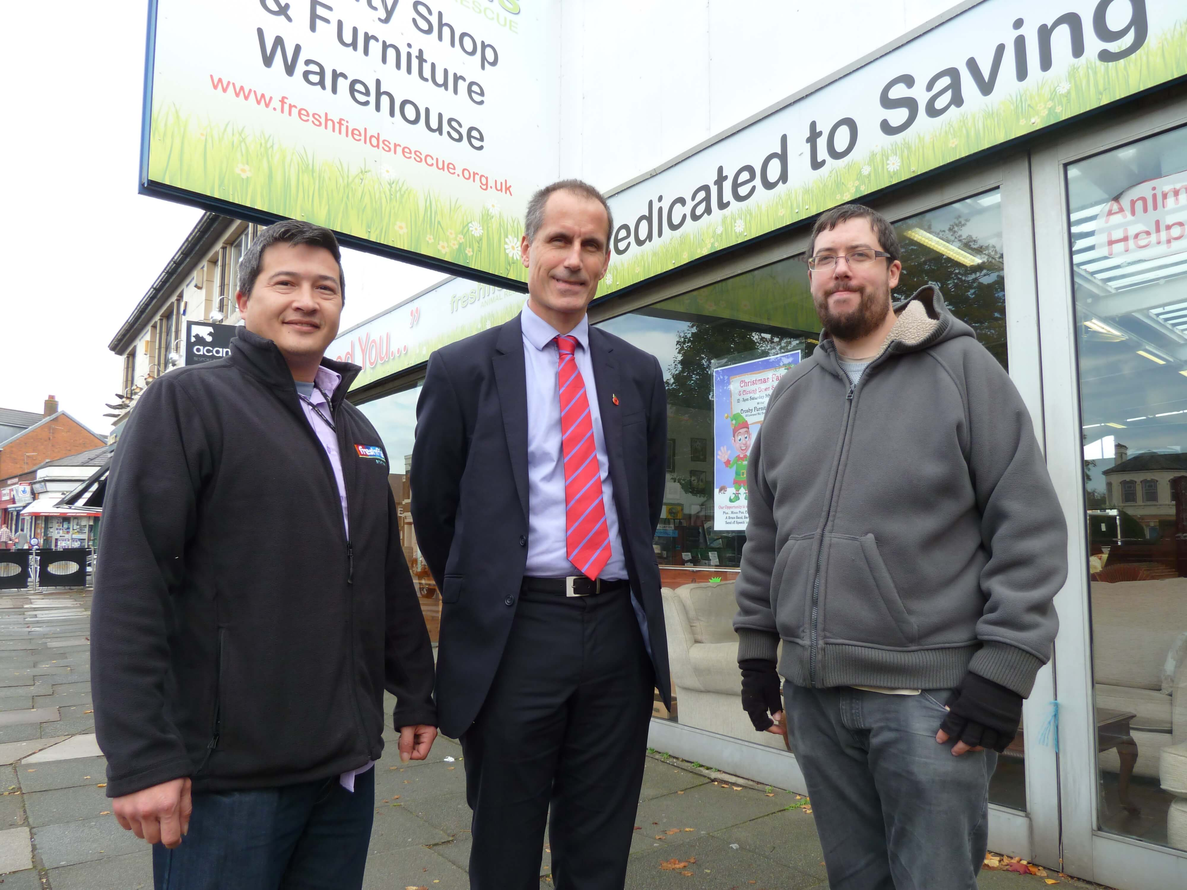 Freshfields Animal Rescue store manager Richard lee and volunteer Joe Smith with MP Bill Esterson.