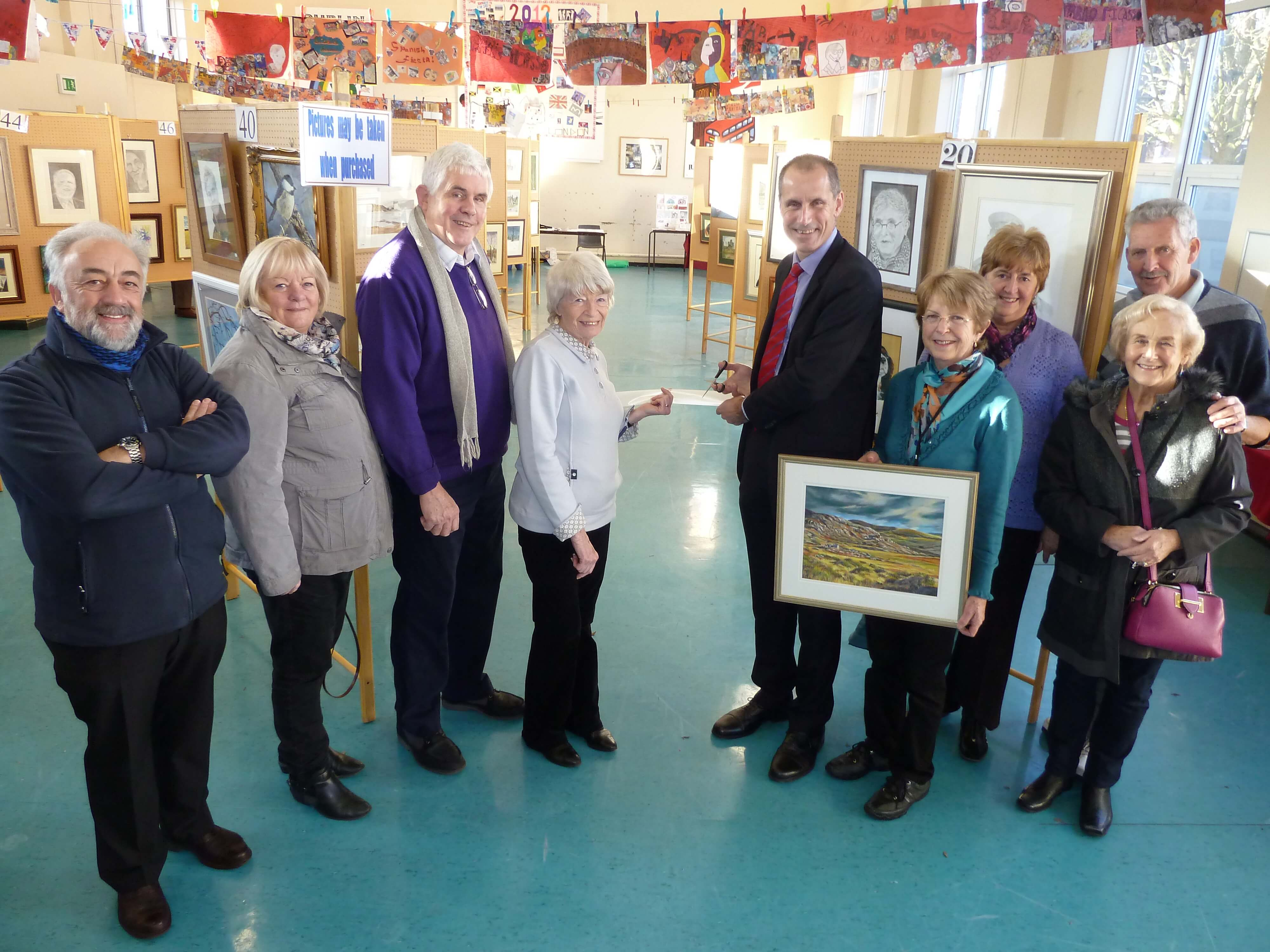MP Bill Esterson with members of Maghull Art Group at their winter exhibition at Deyes High School.