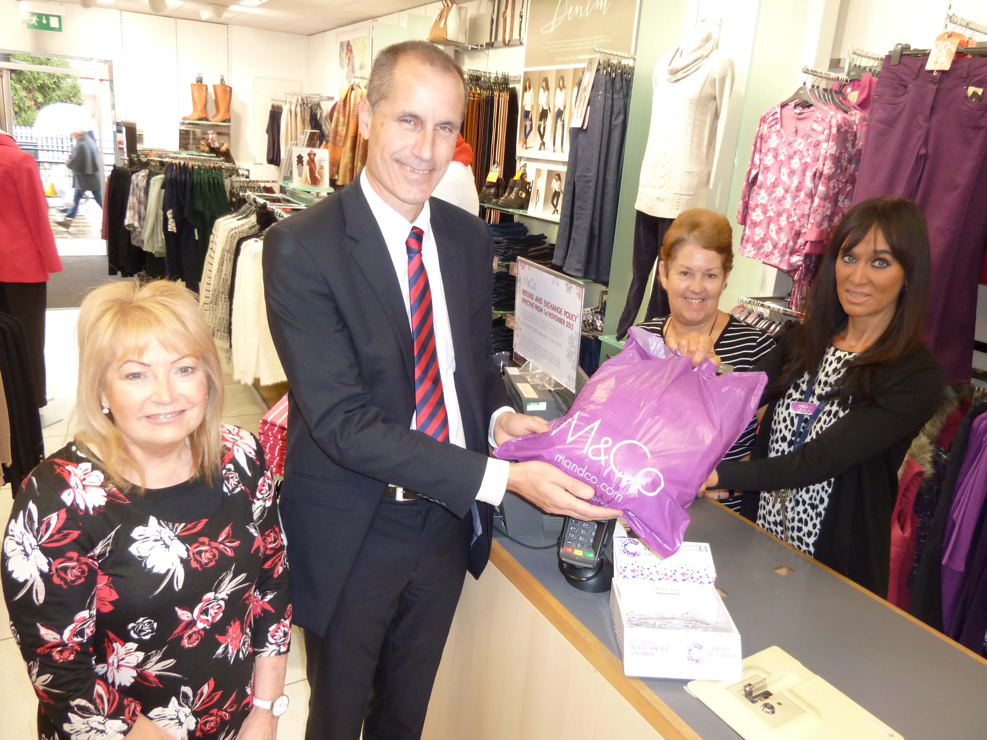 M&Co Formby's Cancer Research UK Charity Fashion Show organiser Sheila Leathley, assistant Val Saunders and store manager Sue Budworth with MP Bll Esterson.