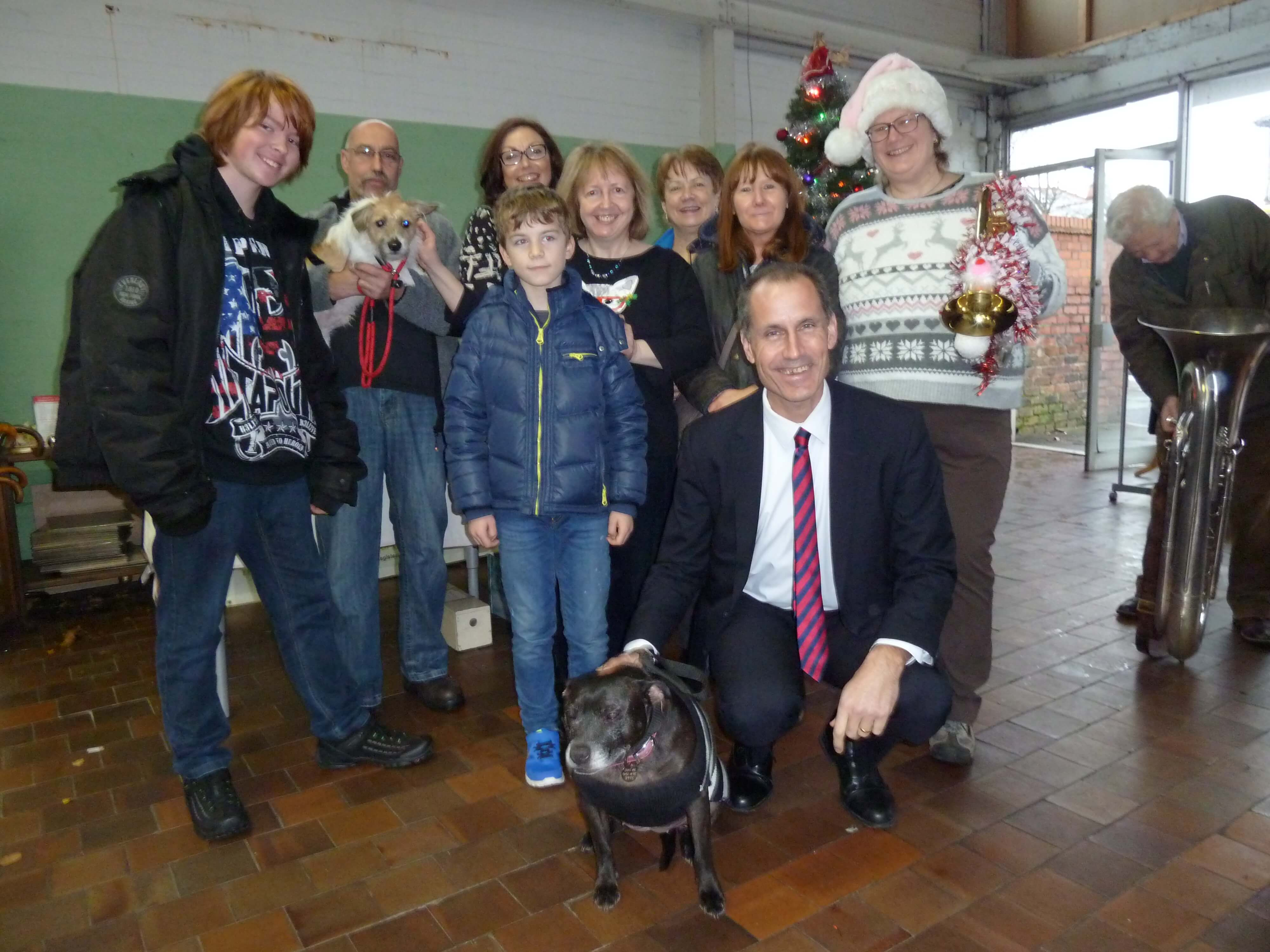 Bill Esterson with Freshfields Animal Rescue fundraiser Debbie Hughes and supporters of the charity at the Crosby shop's Christmas fair.