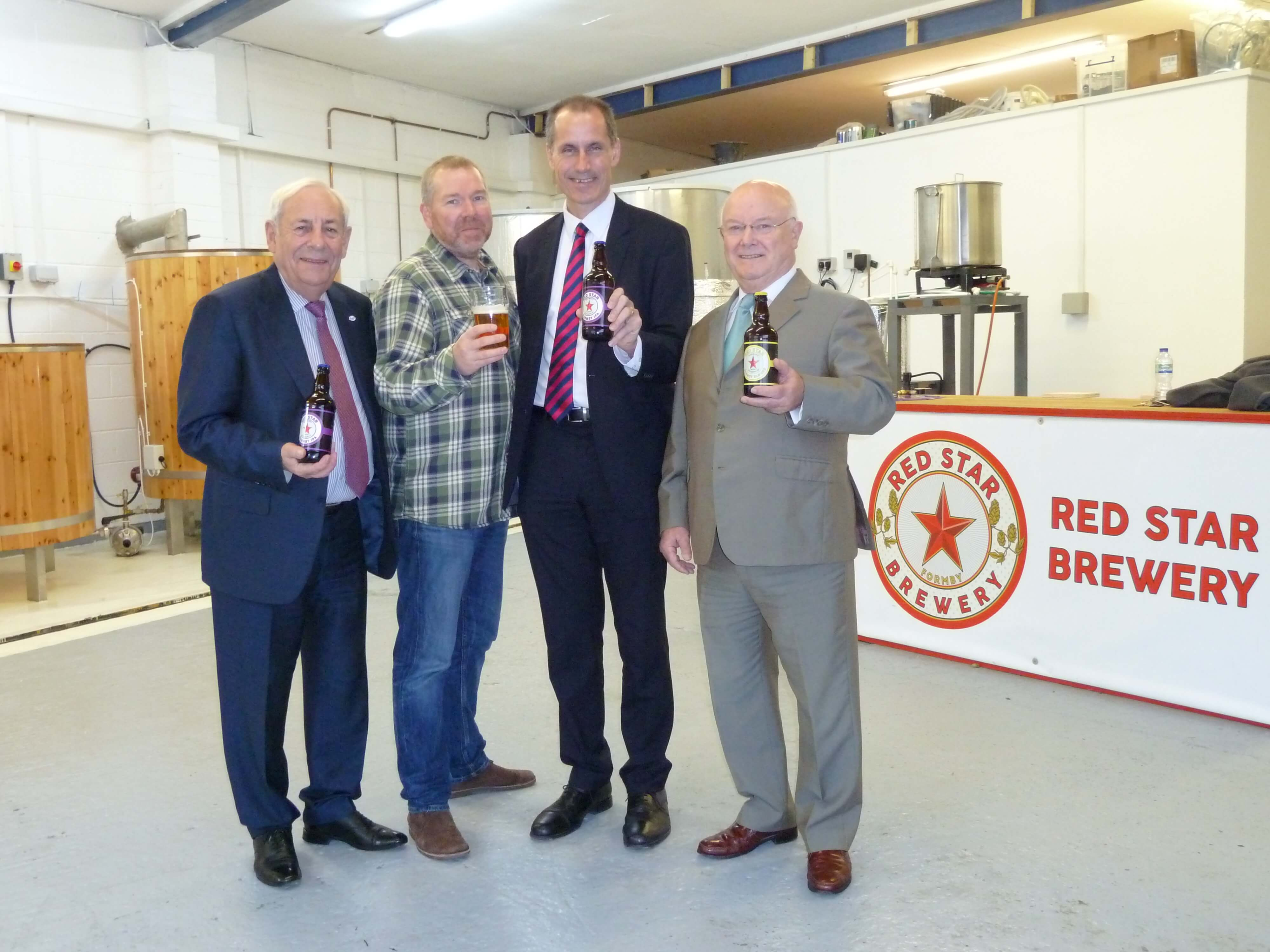 Bill Esterson and Federation of Small Businesses national chairman John Allen and Merseyside branch chairman Chris Burgess at Red Star Brewery with co-founder Glen Monaghan.
