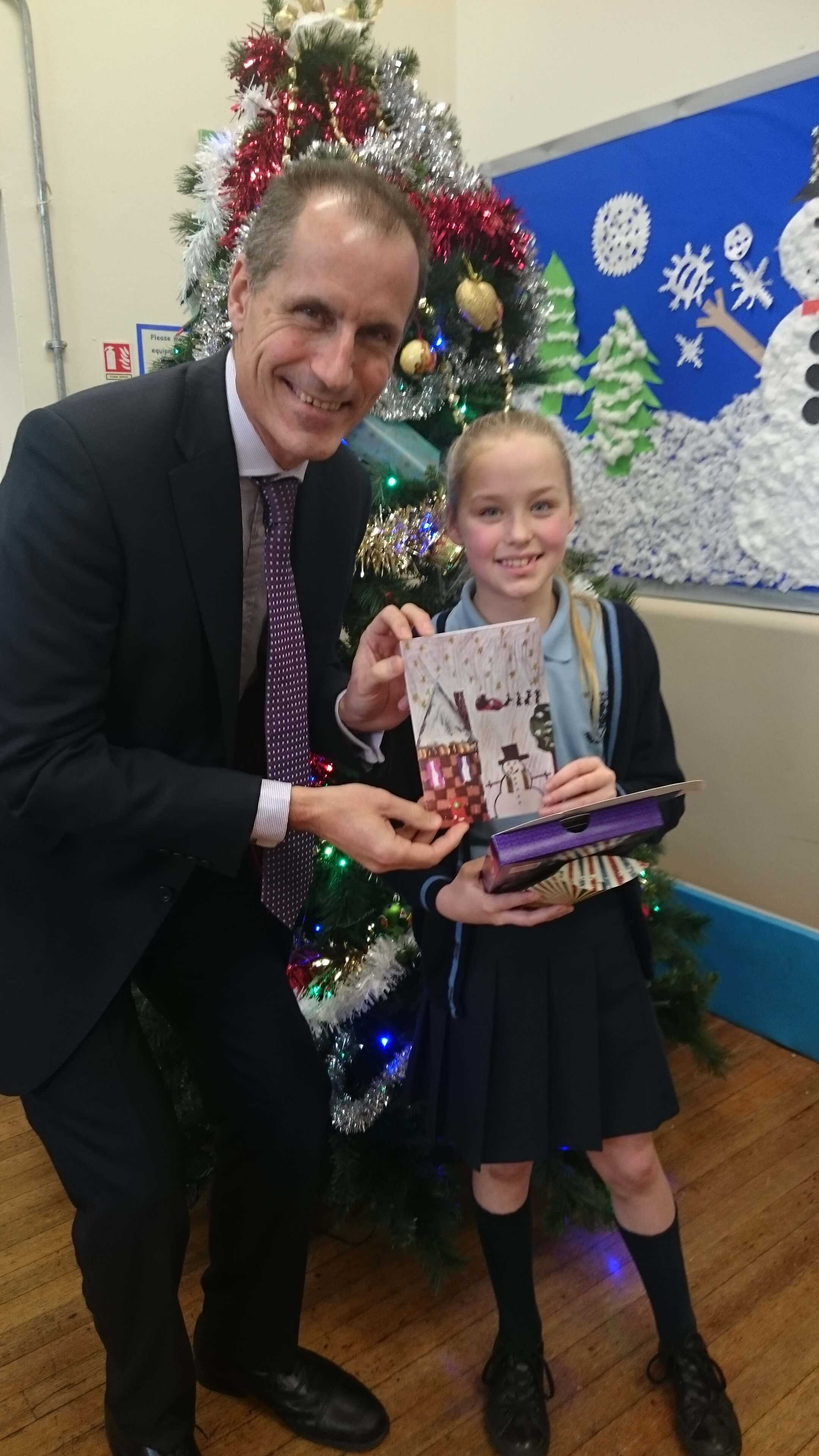 Sefton Central MP Bill Esterson with this year's Christmas card competition winner Isobel Swift