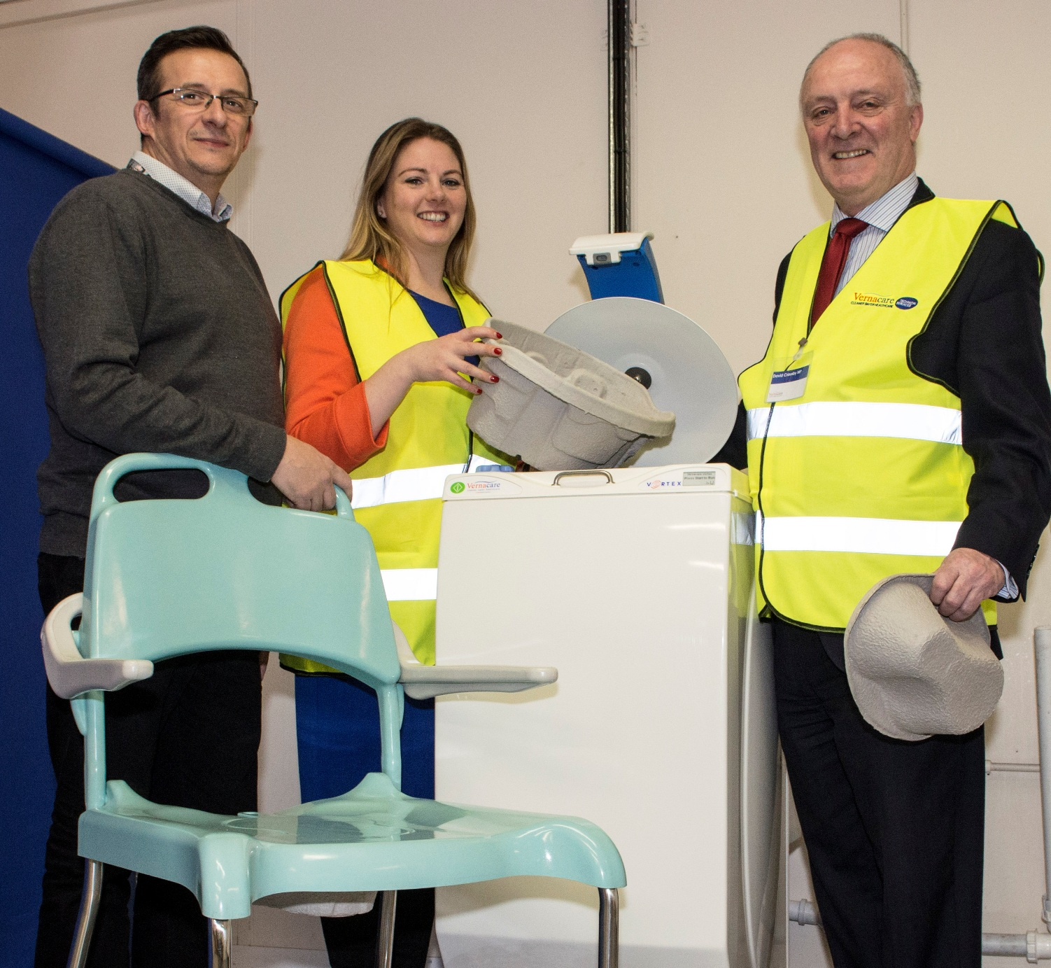 Pictured_(l-r)_in_Vernacare's_RD_centre_are__Wayne_Nelson_and_Emma_Sheldon_of_Vernacare_and_David_Crausby_MP_viewing_the_company's_innovative_produc.jpg