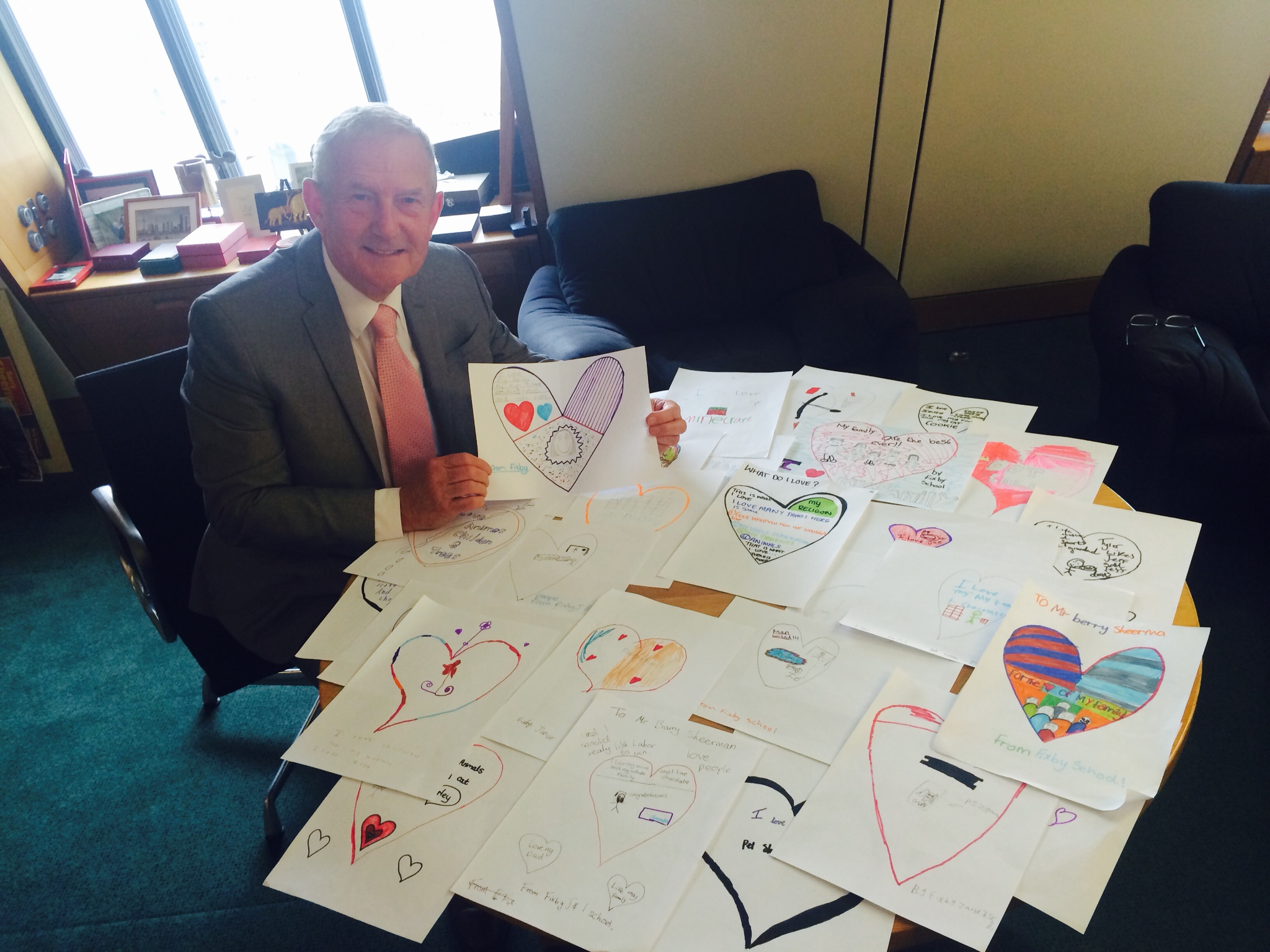 Barry Sheerman MP looking at cards produced by children from Huddersfield's Fixby Infants school