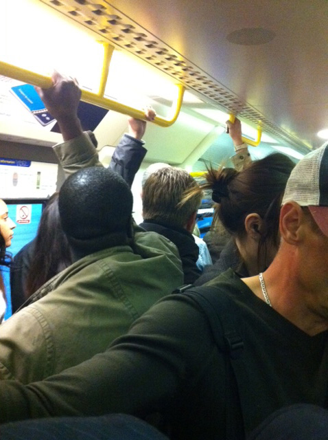 Packed_train_carriage.jpg