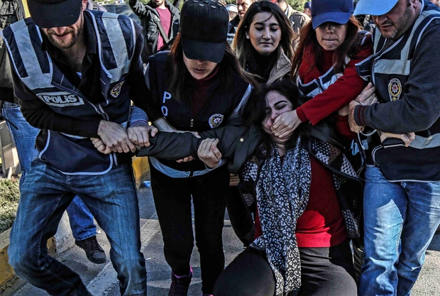Turkish_police_officers_detain_former_HDP_parliamentarian_Sebahat_Tuncel__on_4_November_2016_during_a_protest_outside_Diyarbakir_courthouse_(AFP).jpg