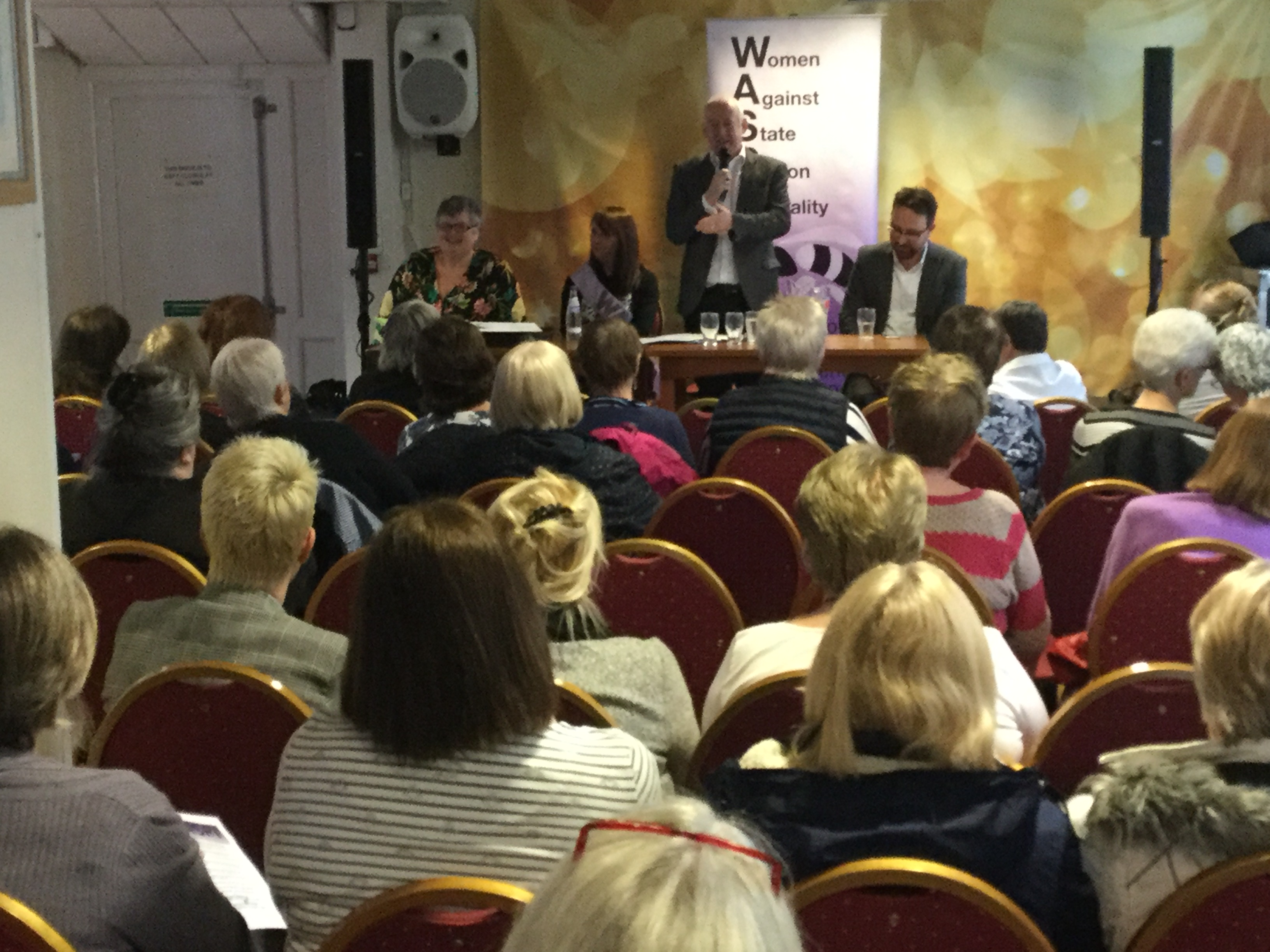 Carolyn Harris, Sue Jarman, Wayne David and Hefin David address a meeting about state pension inequality