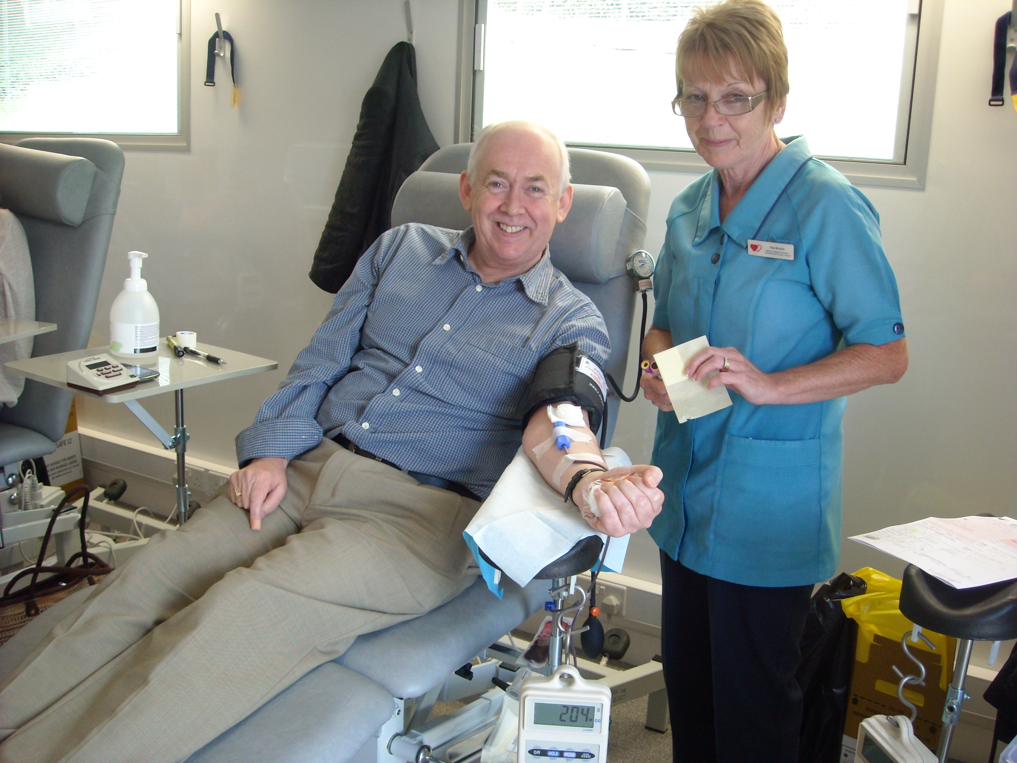 Wayne giving blood