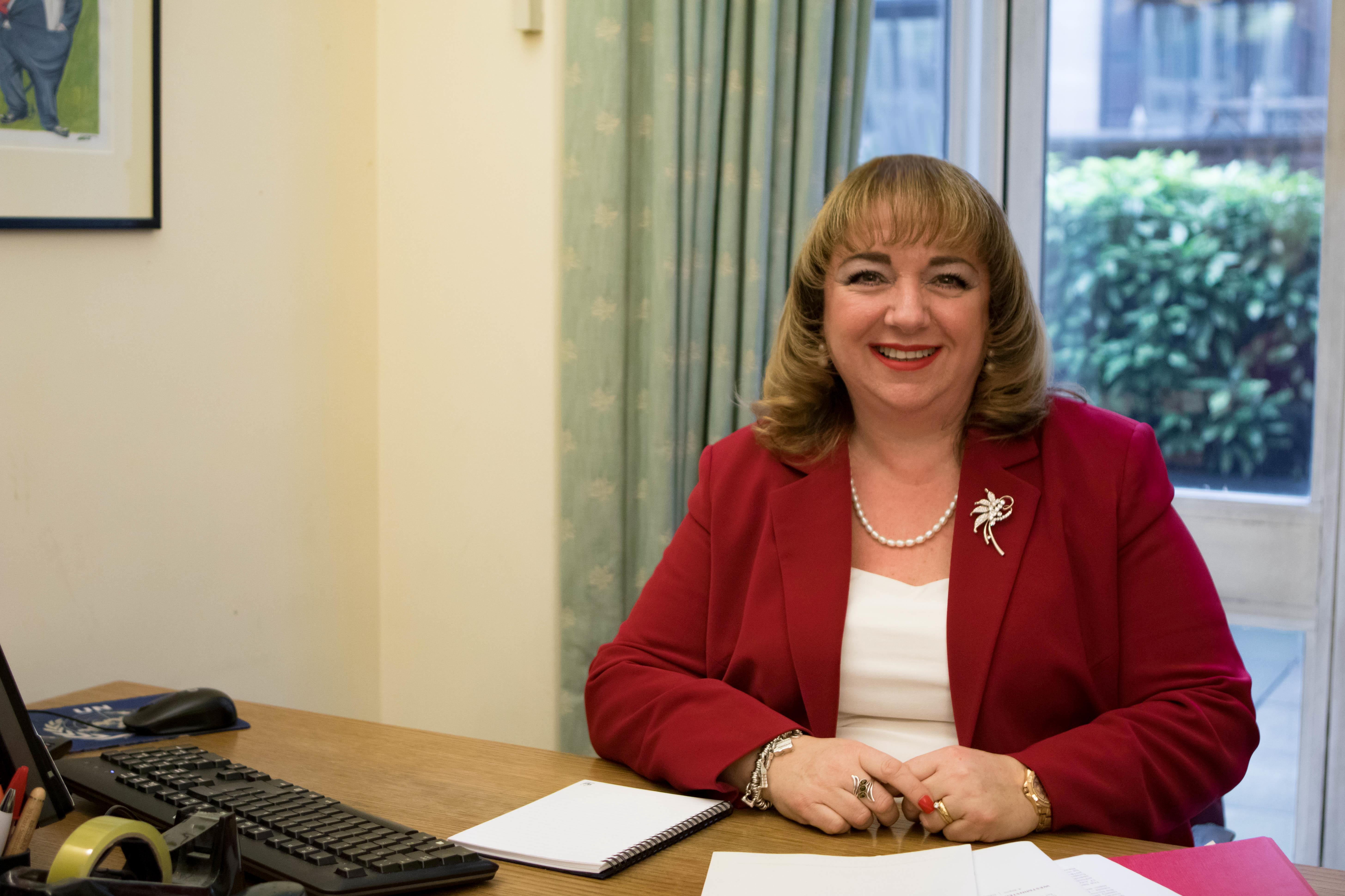 Image shows Sharon at a desk
