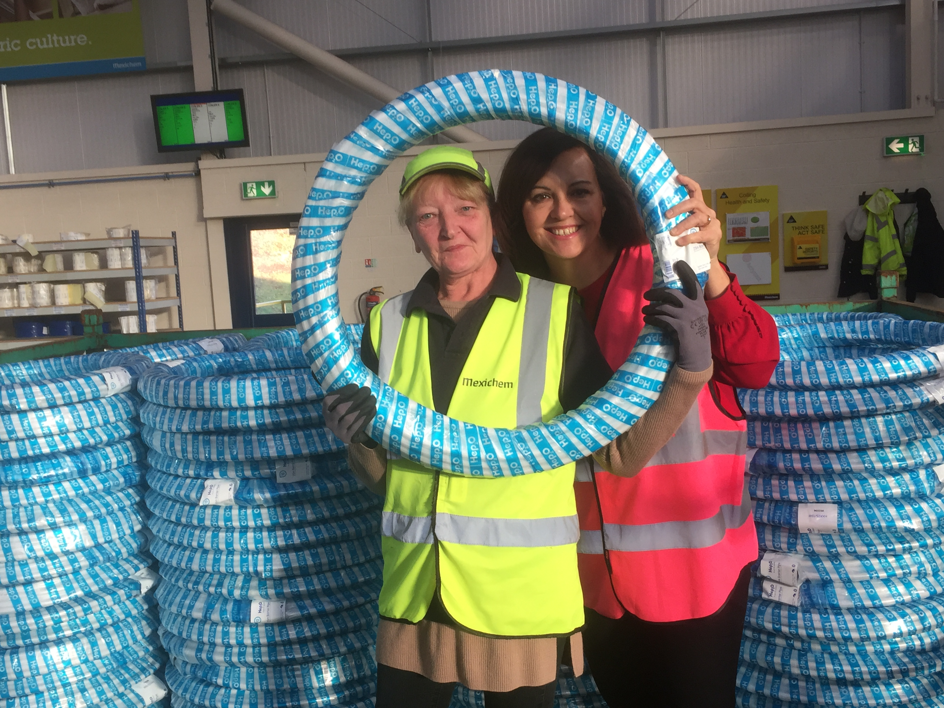 Wavin_June_Prowse_shows_Caroline_some_of_the_18_tonnes_of_pipe_produced_daily.JPG