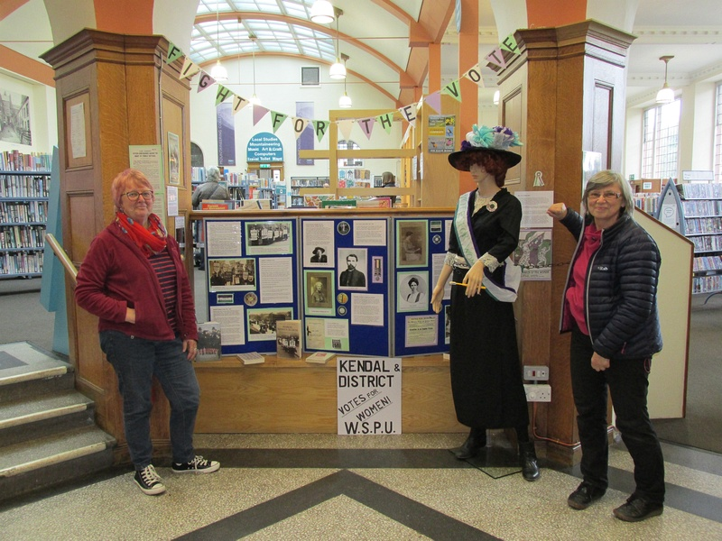 Labour candidates Penny Henderson (Windermere) and Hanna Burke (Kendal Rural) with the South Lakes Labour Suffragette Display in Kendal Library