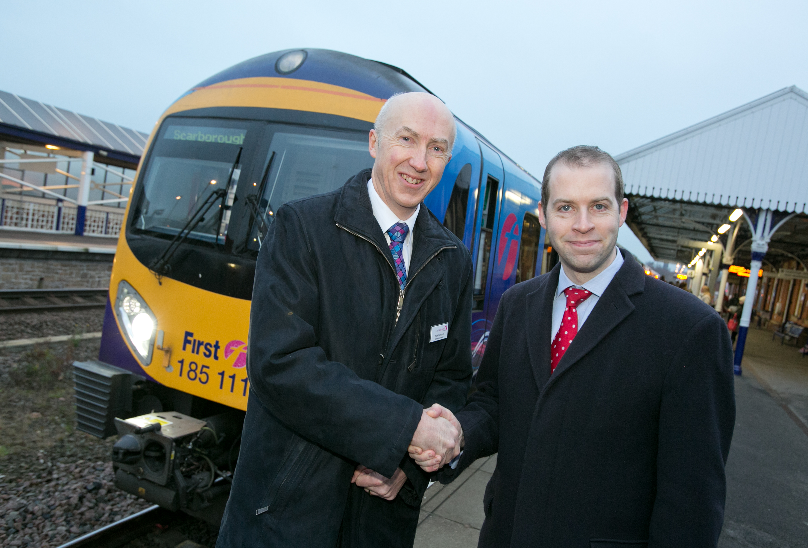 Jonathan_Reynolds_MP_and_Nick_Donovan_FTPE_MD_celebrate_the_launch_of_new_rail_services_from_Stalybridge_2.jpg