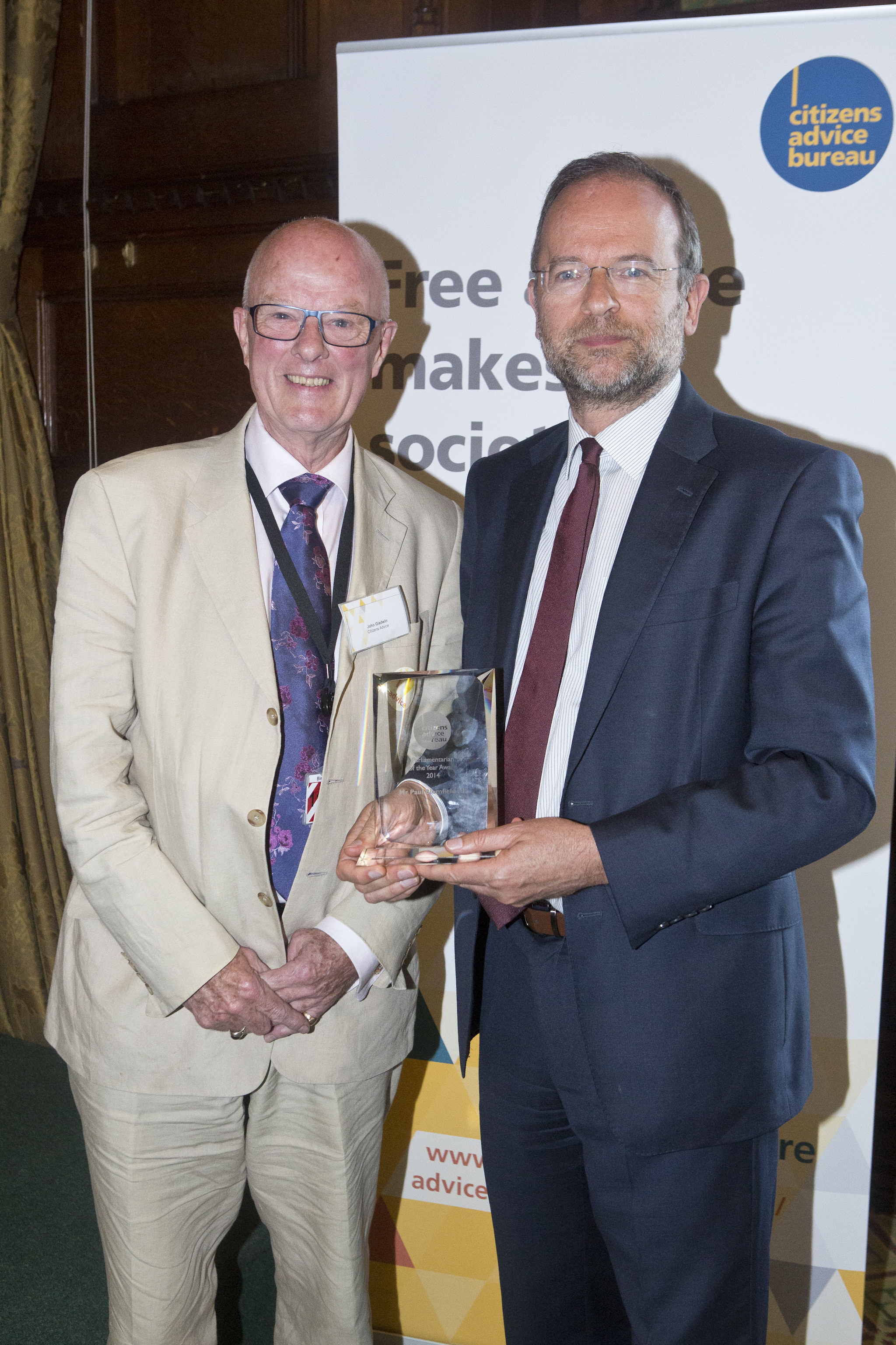 Paul_with_Rt_Rev_John_Gladwin__Chairman_of_Citizens_Advice_accepting_award.jpg