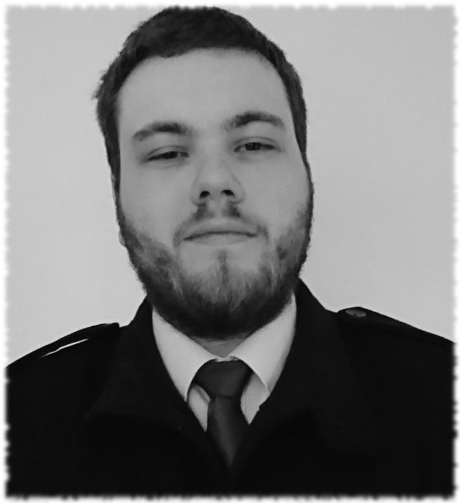 A black and white picture. Harley has short dark hair and is wearing a uniform jacket.