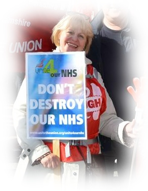 A portrait of Joyce; blond, smiling, holding a sign which reads 'Don't Destroy Our NHS'