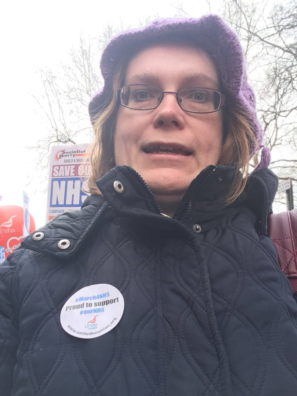 Ruth McCorry; a blonde woman smiling, wearing a Unite the Union NHS sticker