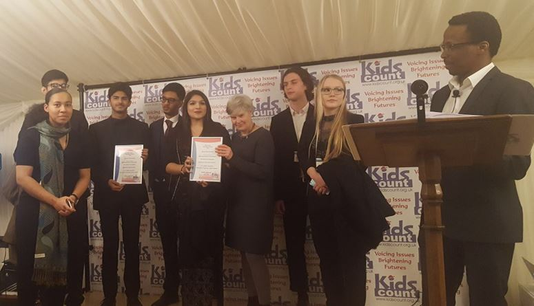 stretford_students_presented_with_their_award.JPG