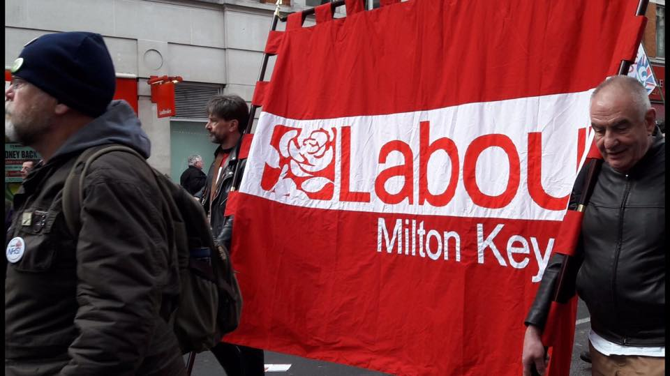 MK_Party_members_carry_our_banner.jpg