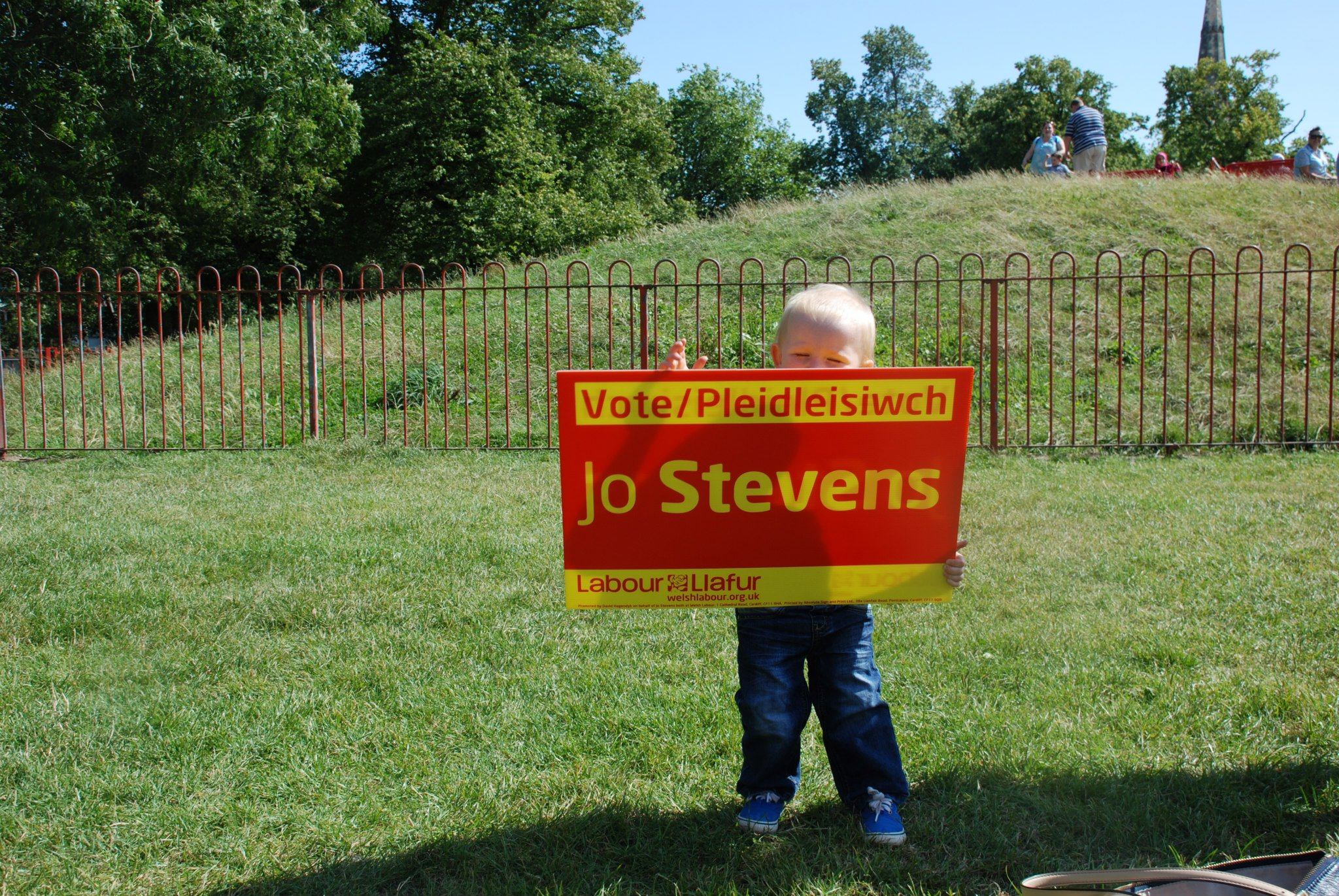 Young member holding campaign sign