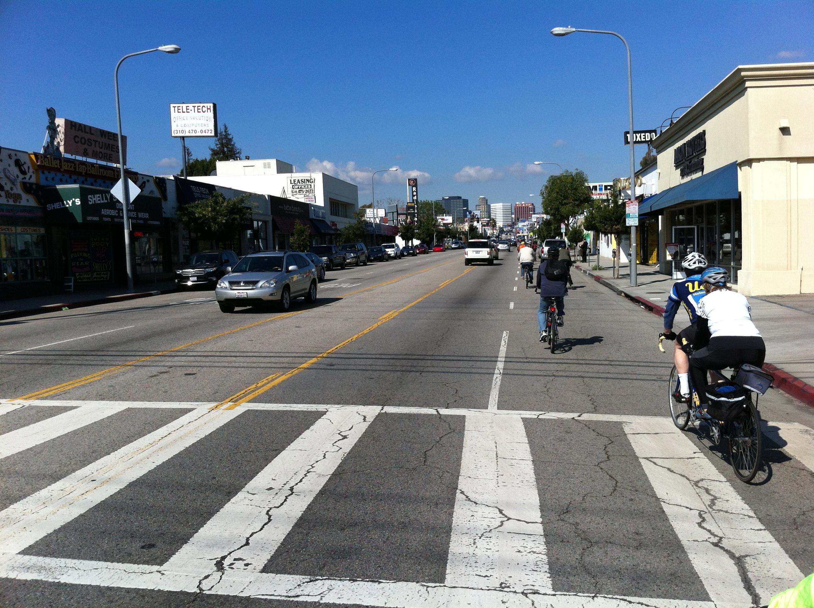 People bike on Westwood Blvd.