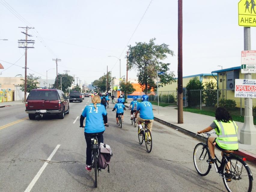People bike on Central Avenue. Photo via Experience Central.