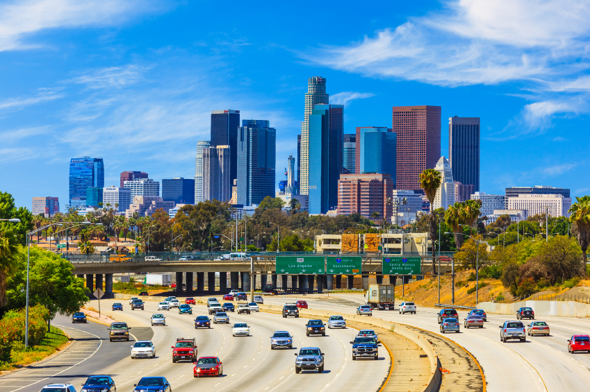 Skyline_of_LA_with_Freeway_Traffic.jpg