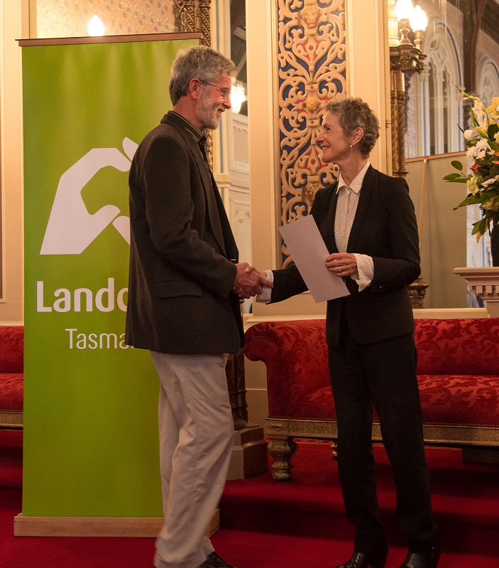 Image of Paul Thomas receiving his Roll of Honour award from the Governor Kate Warner