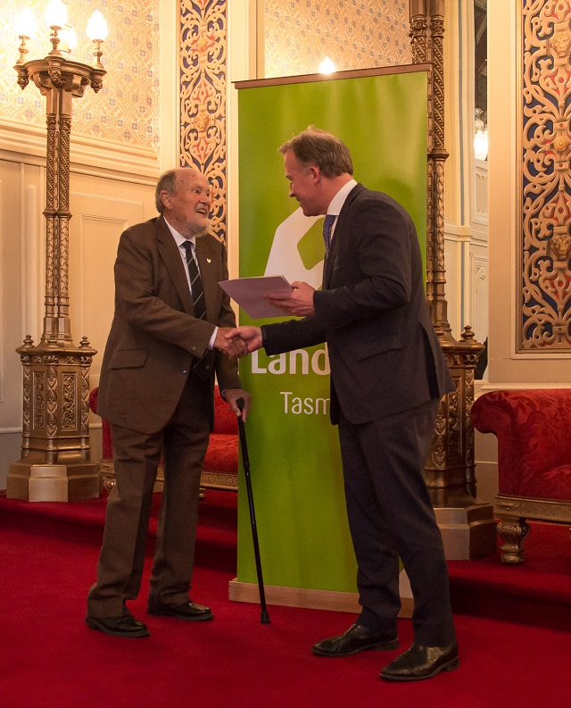 Image of 2019 Tas Premier's Landcare Award Winner Dr. Graeme Stevenson accepting his award from then Premier Will Hodgman