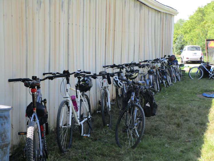 EnvtHam_bike_trip_bikes_lined_up_against_barn_Aug_20_2016.png