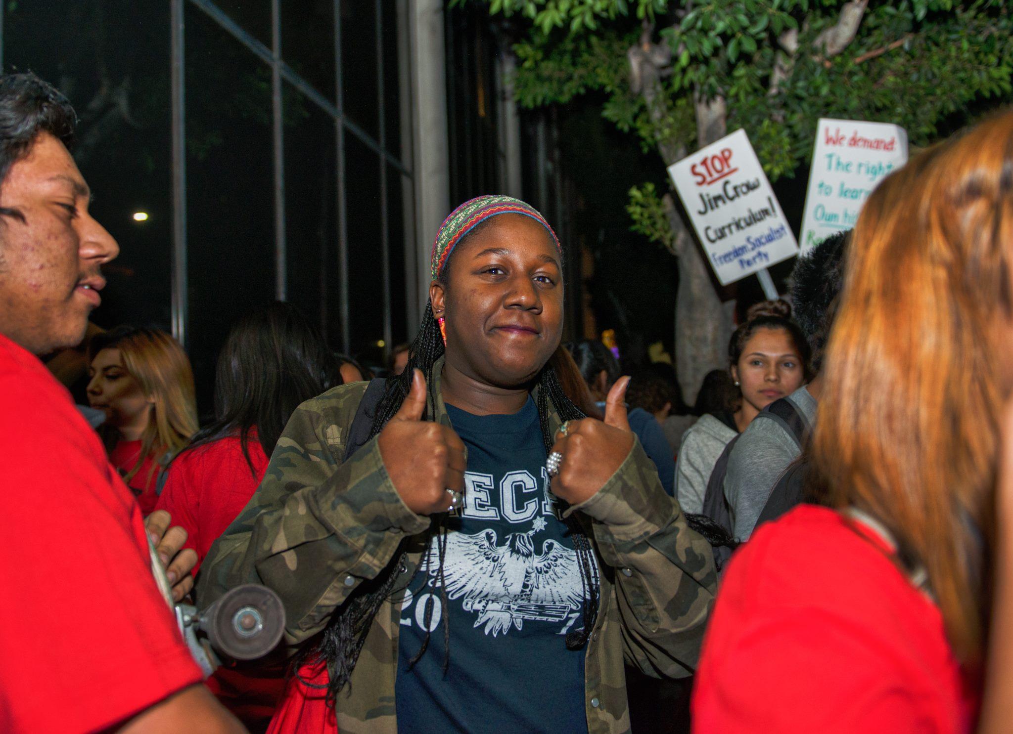 credit_Revo_Grafia_-_Rally_outside_with_Maya_Angelou_student_Michelle_Thomas_-_ESNC.jpg