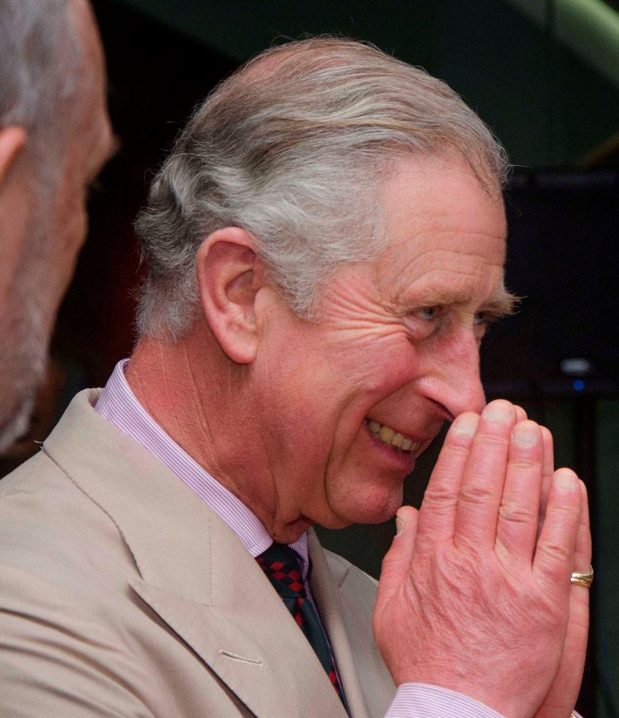 Prince Charles praying to Zeus (AKA Satan).