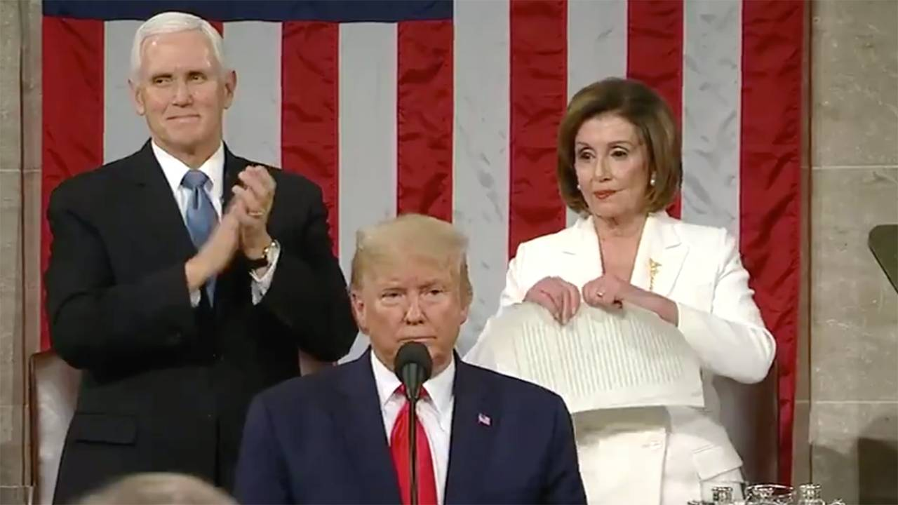 During Trump's State of the Union 2020, Nancy Pelosi rips her copy of the speech to shreds.