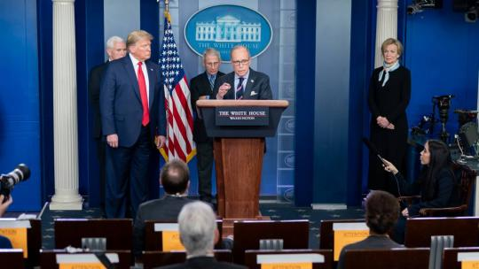 President Donald J. Trump looks on as Director of the National Economic Council Larry Kudlow delivers remarks during a coronavirus update briefing Tuesday, March 24, 2020, in the James S. Brady Press Briefing Room of the White House. (Official WH Photo)