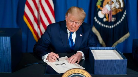 President Donald J. Trump signs H.R. 133, a consolidated appropriations Act for the fiscal year ending Sept. 30, 2021, Sunday evening Dec. 27, 2020, at Mar-a-Lago in Palm Beach, Fla.