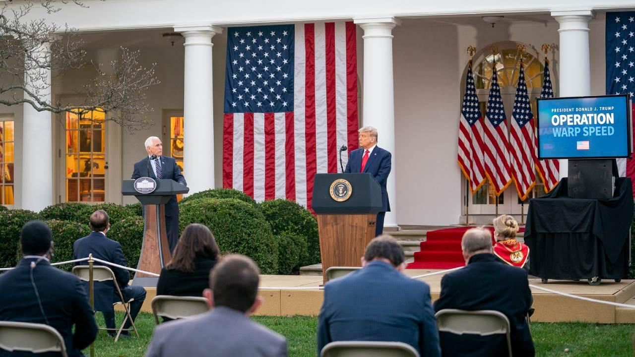 President Donald J. Trump listens as Vice President Mike Pence delivers remarks Friday, Nov. 13, 2020, during an update of Operation Warp Speed in the Rose Garden of the White House. (Official White House Photo by Delano Scott)