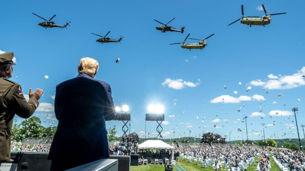 President Trump, joined by LTG Darryl Williams, 60th Superintendent of the United States Military Academy at West Point, observes a helicopter flyover at the conclusion of the United States Military Academy commencement ceremony Saturday, June 13, 2020.