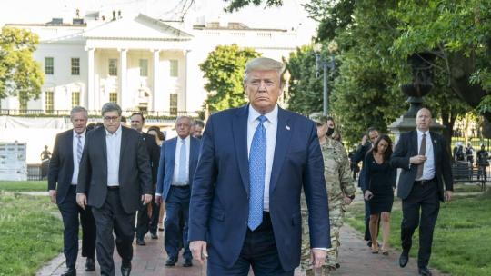 President Donald J. Trump walks from the White House Monday evening, June 1, 2020, to St. John's Episcopal Church, known as the church of Presidents's, that was damaged by fire during demonstrations in nearby LaFayette Square Sunday evening.