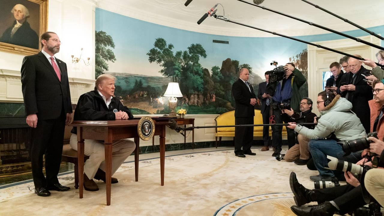 President Trump, joined by Secretary of Health and Human Services Alex Azar, takes questions from the press following the signing of the congressional funding bill for coronavirus response Friday, March 6, 2020. (Official White House Photo by Tia Dufour)