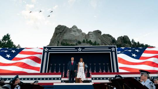 President Donald J. Trump and First Lady Melania Trump watch a flyover during a Fourth of July celebration Friday, July 3, 2020, at Mount Rushmore National Memorial in Keystone, S.D. (Official White House Photo by Andrea Hanks)