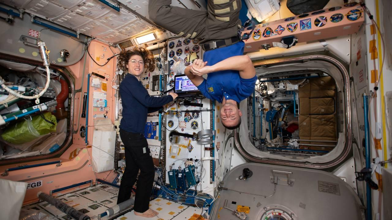 NASA astronauts Christina Koch and Andrew Morgan are pictured working inside the Unity module which connects the International Space Station's U.S. segment with the Russian segment. (July 23, 2019)
